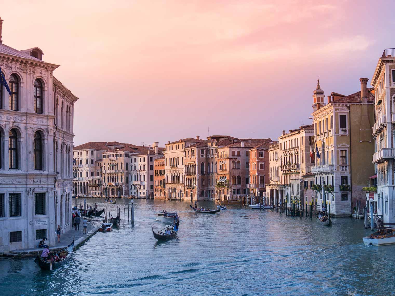 Clients enjoying gondola tour of Venice.